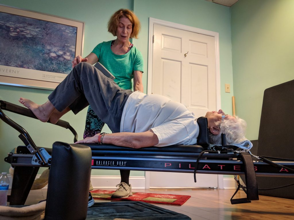 Working with a client on the Reformer